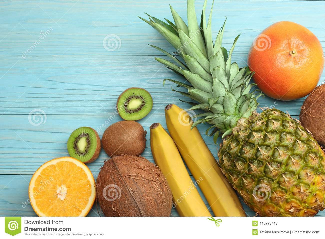Download Mix Of Fresh Coconut, Banana, Kiwi Fruit, Orange And Pineapple On Blue Wooden Background. Top View With Copy Space Stock Image - Image of yellow, copy: 110778413