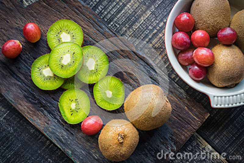 Mix of fresh fruits For good health . Kiwis , red grapes and Or
