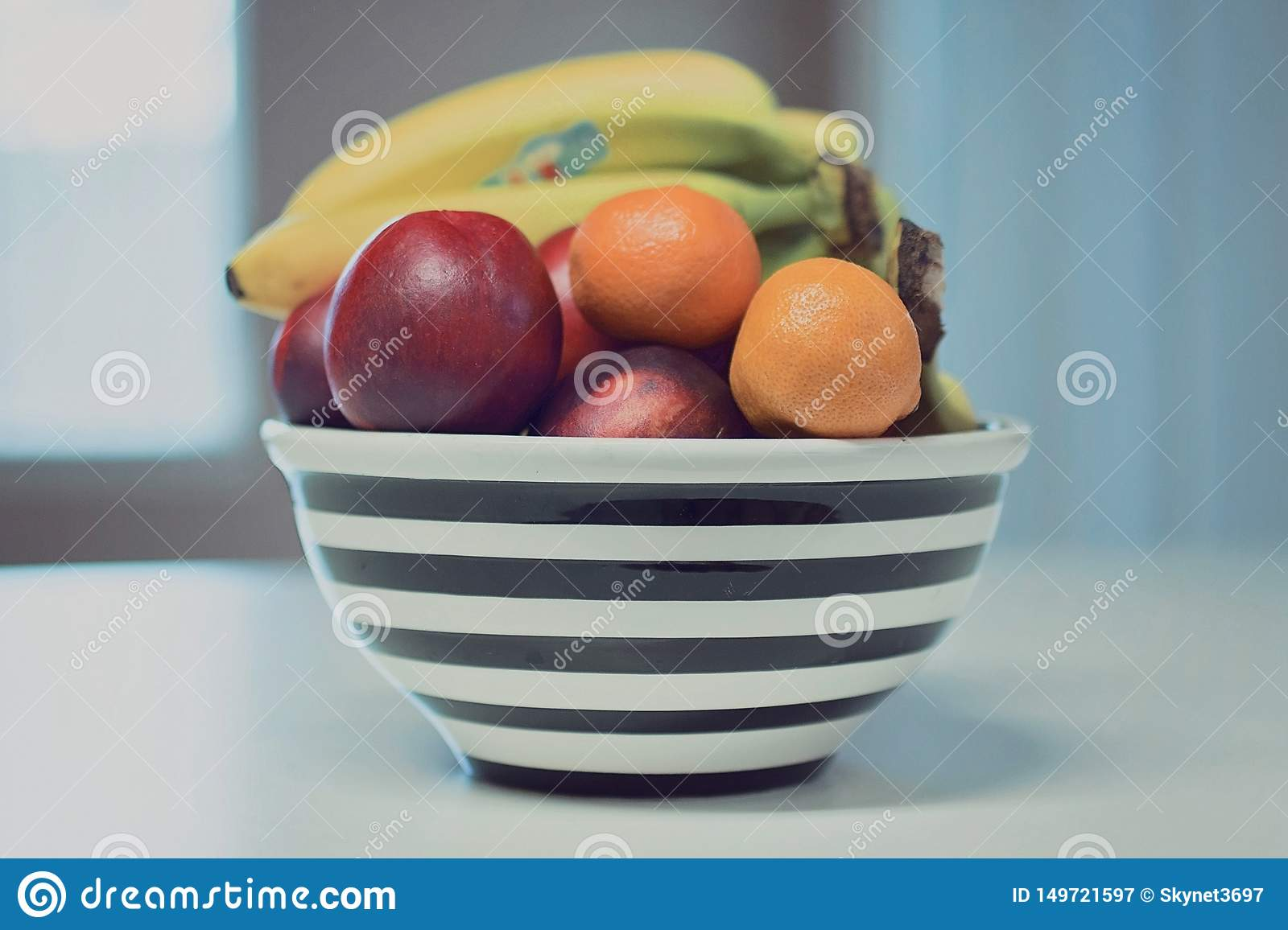 Mix fruits in black bowl