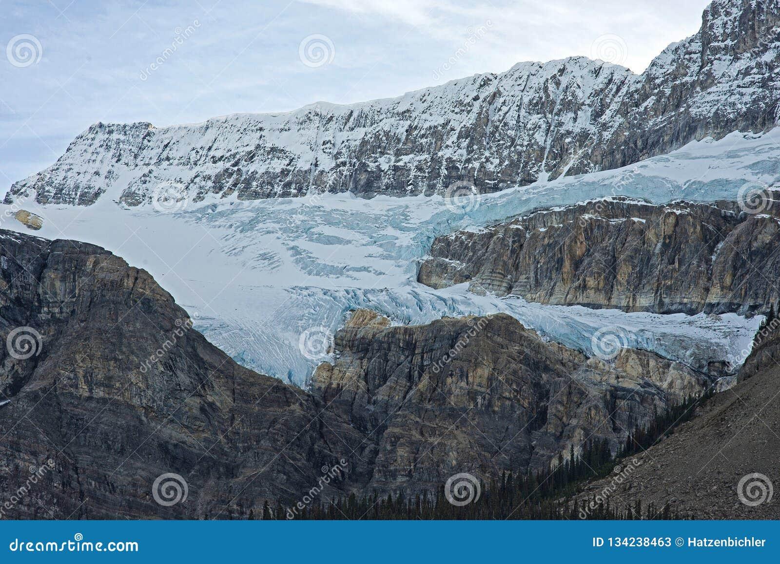 Glacier flowing down a mountain