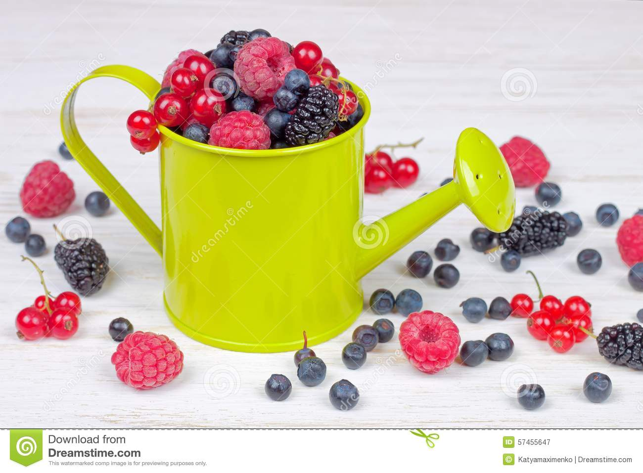 Mixed Berries In Small Decorative Watering Can Stock Photo