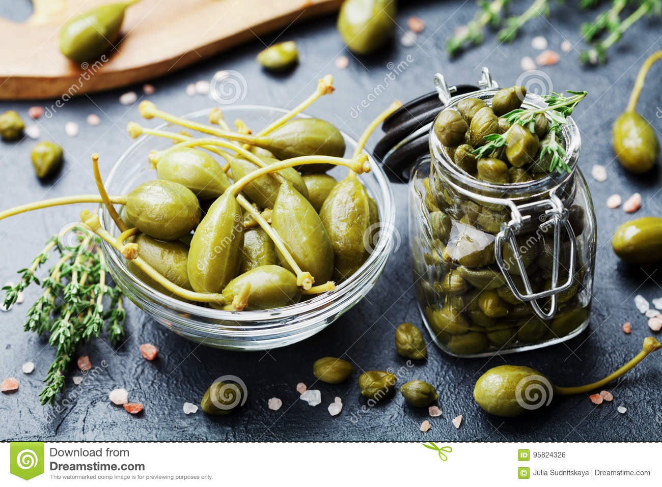 Mixed Capers In Jar And Bowl On Black Kitchen Table. Stock Photo ...