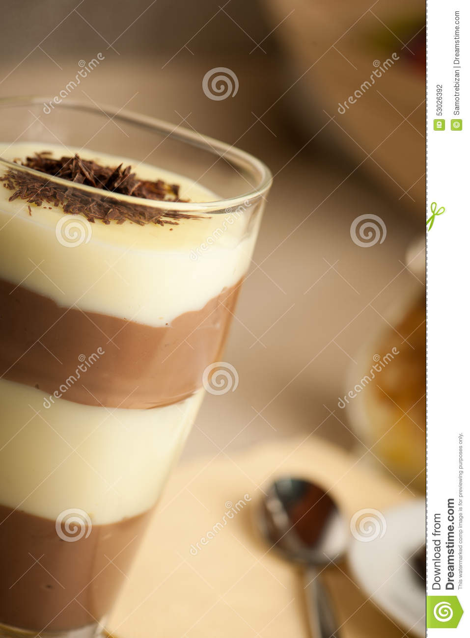 Mixed chocolate and vanilla pudding served in a glass decorated