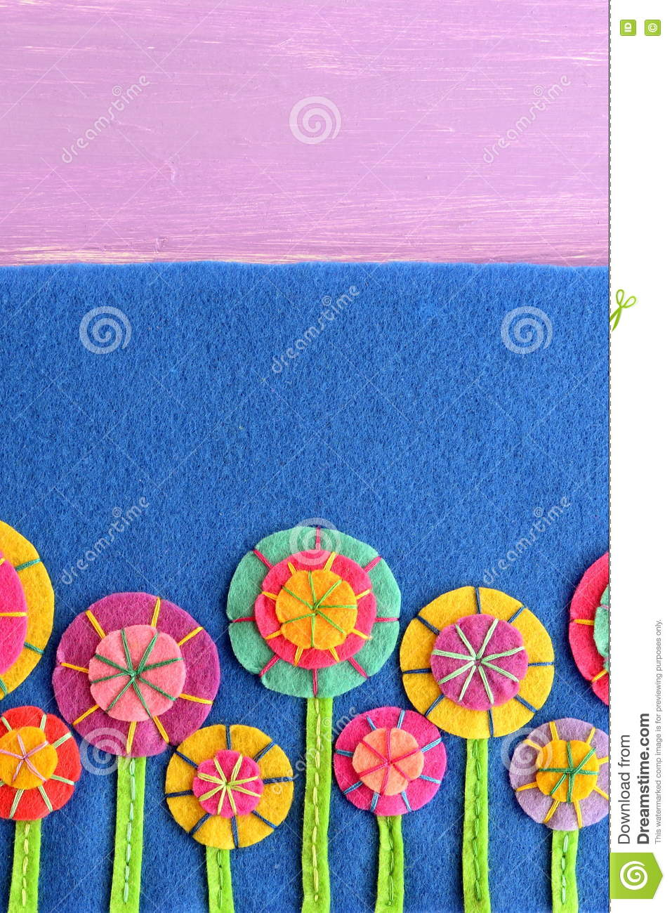 Mixed Felt Flowers On Blue Background With Empty Place For Text