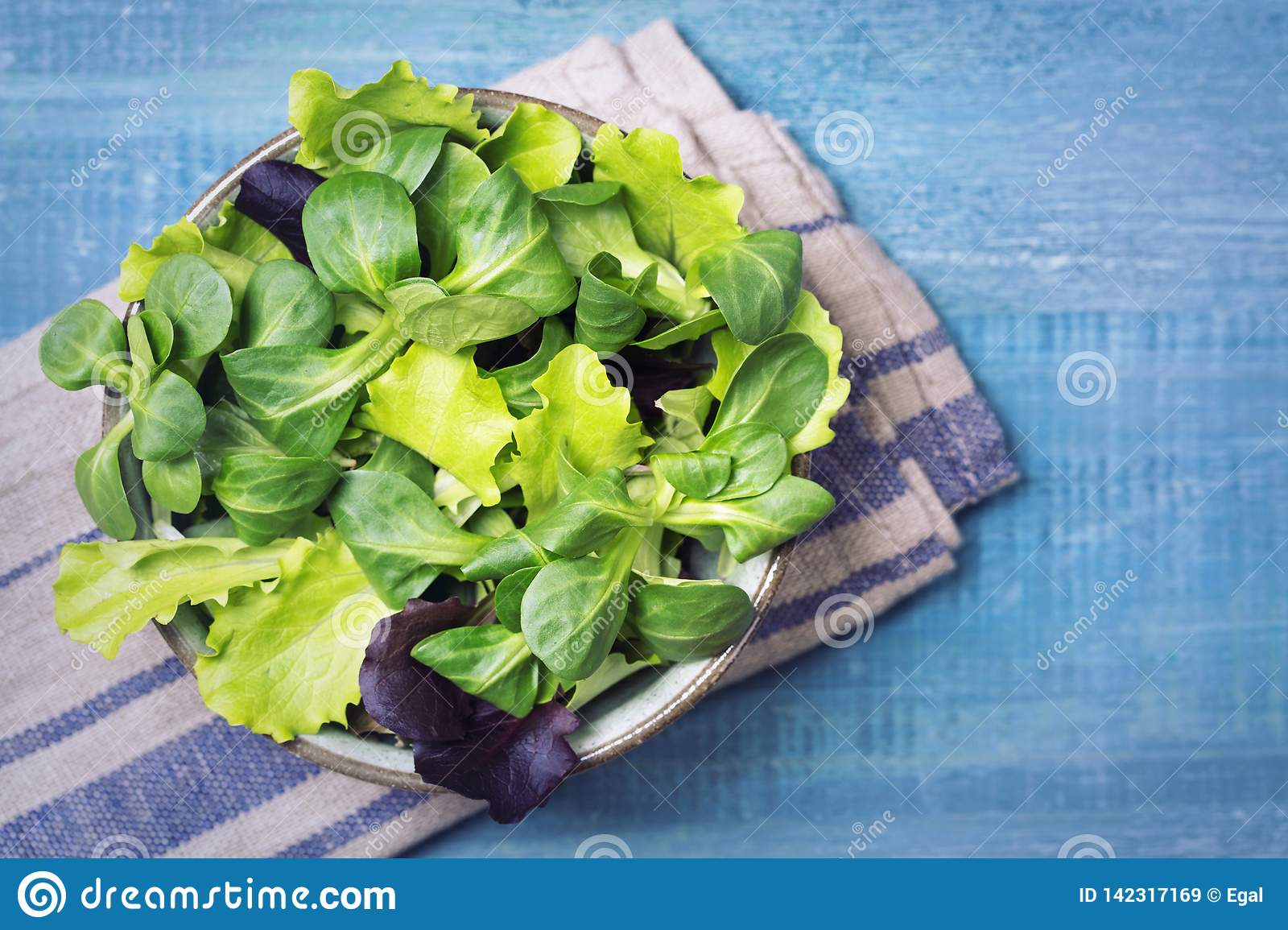 Mixed green salad leaves in a bowl