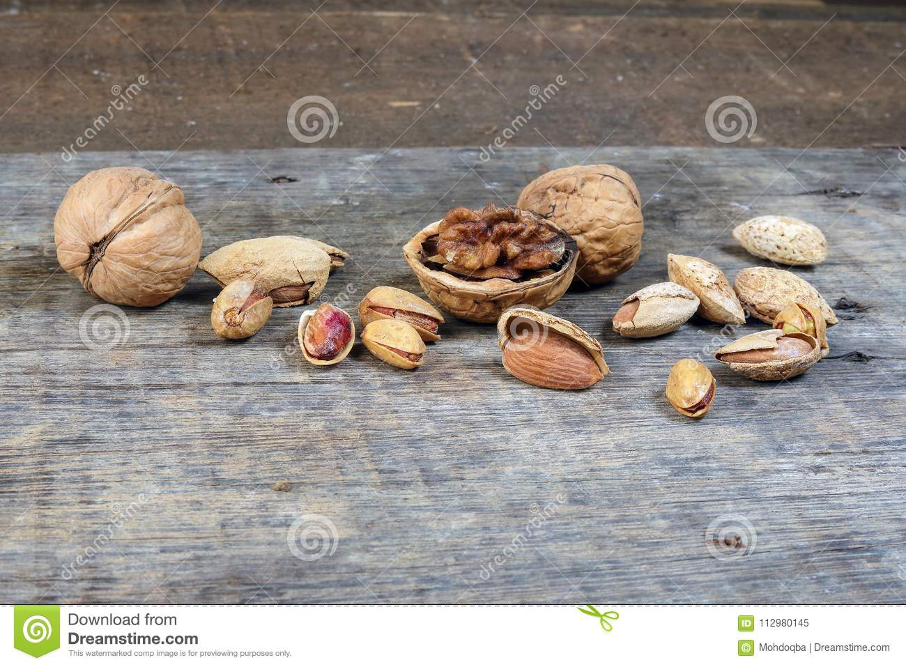 Mixed nut on rustic wood background