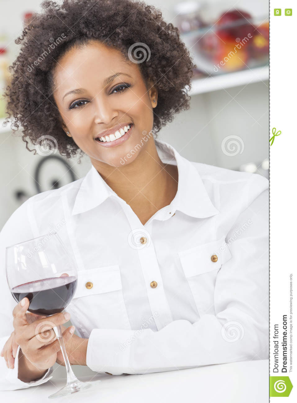 Picture Perfect American Cottage How To Decorate Interiors: Mixed Race African American Girl Drinking Red Wine Stock