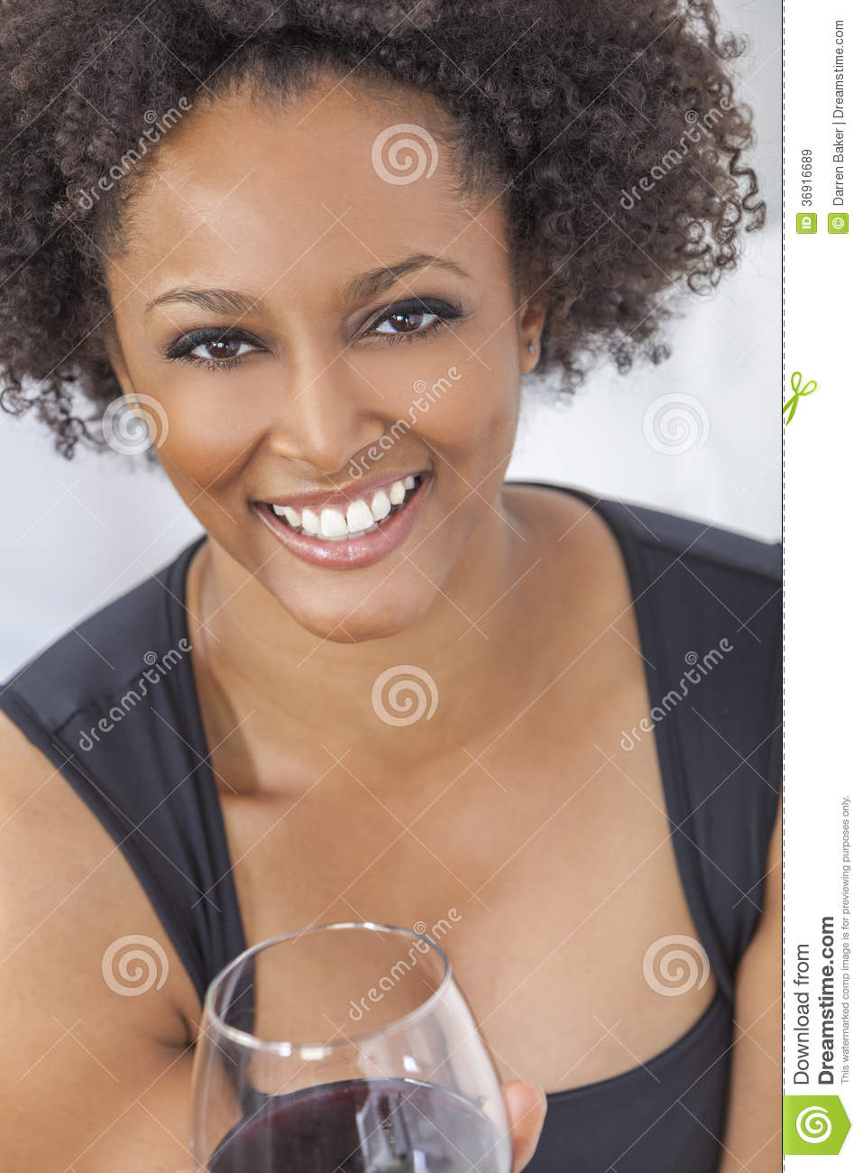 Mixed race african american girl drinking red wine royalty free stock