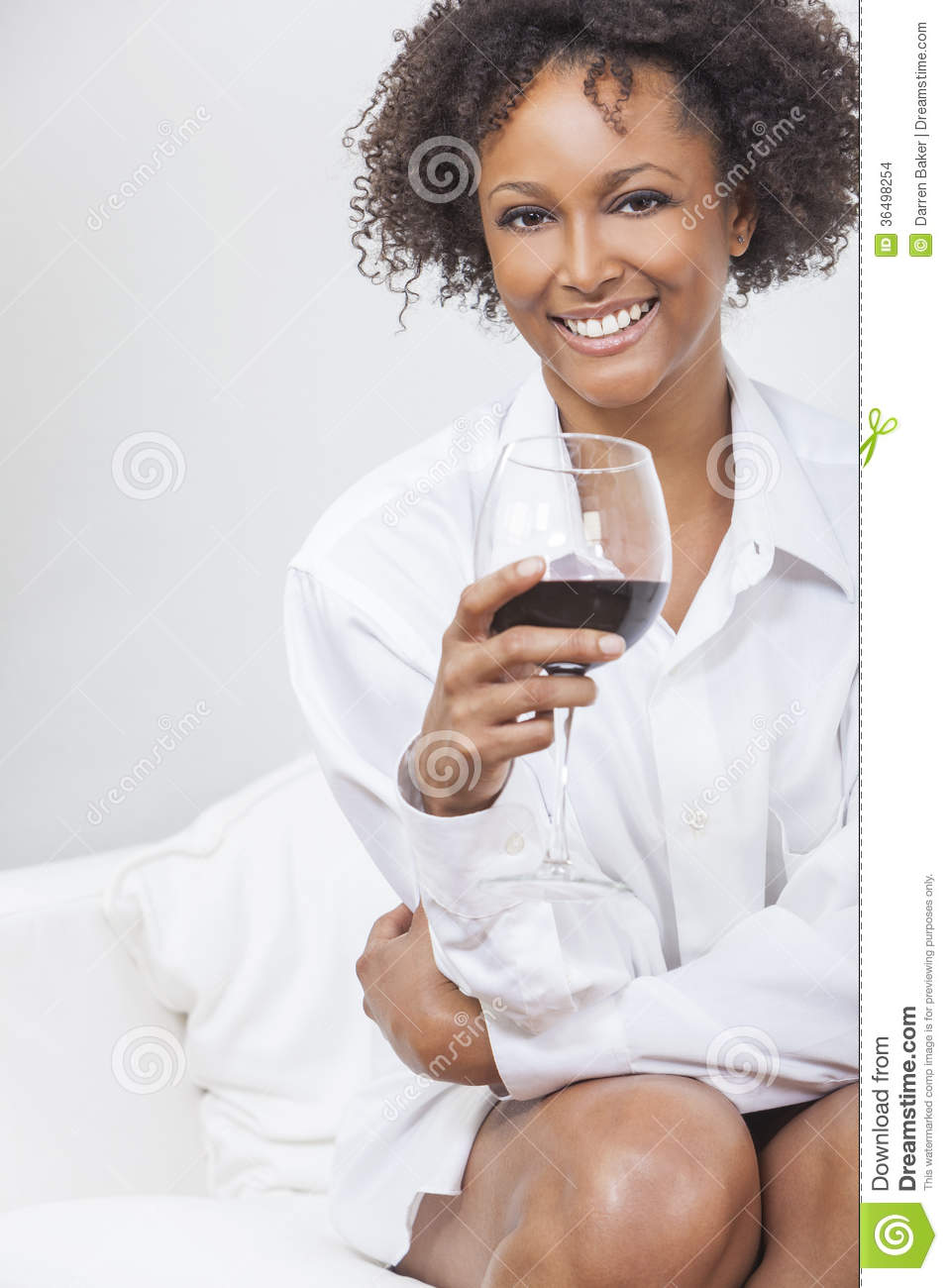mixed race african american girl drinking red wine stock