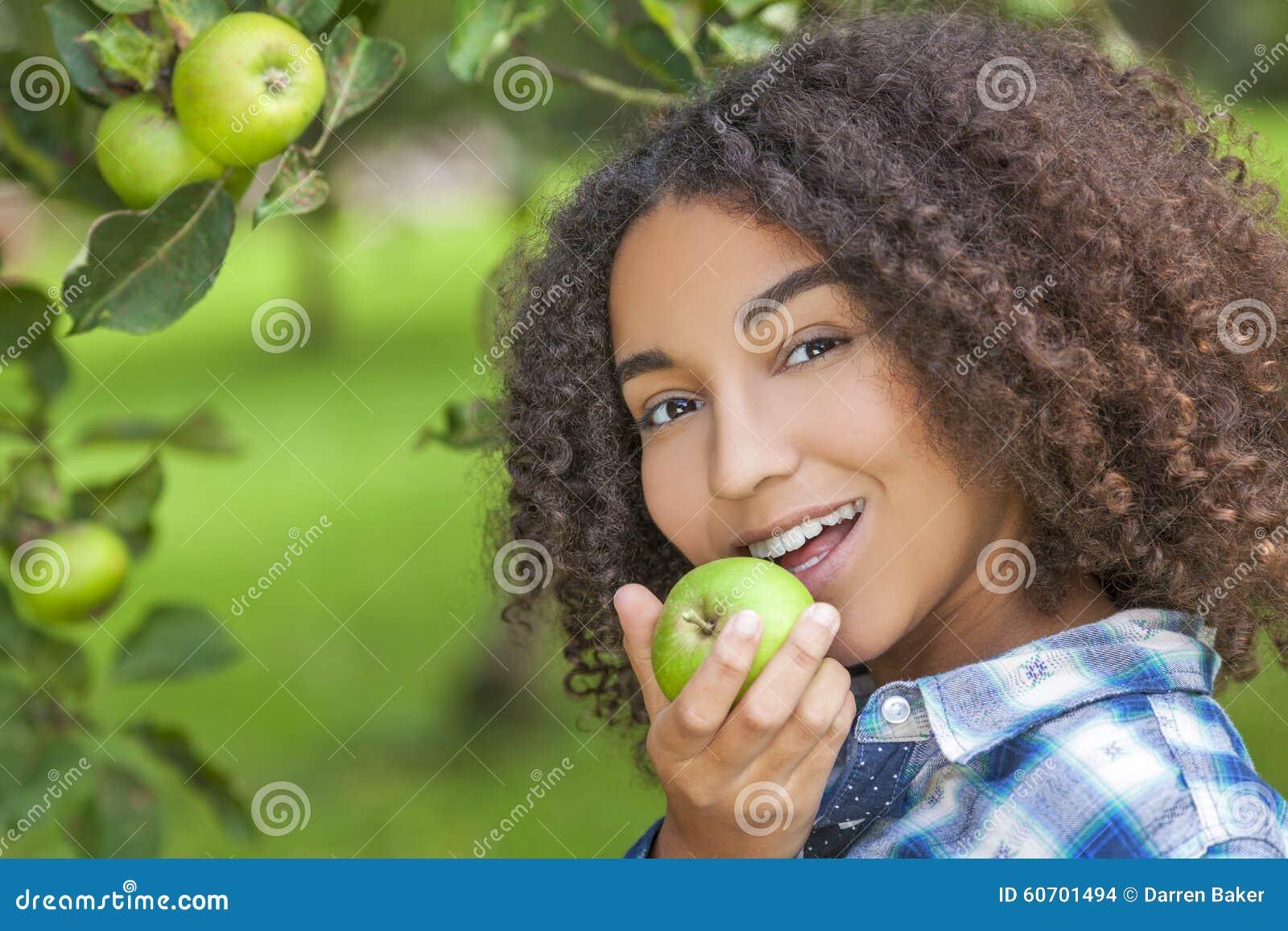 Mixed Race African American Girl Teenager Eating Apple