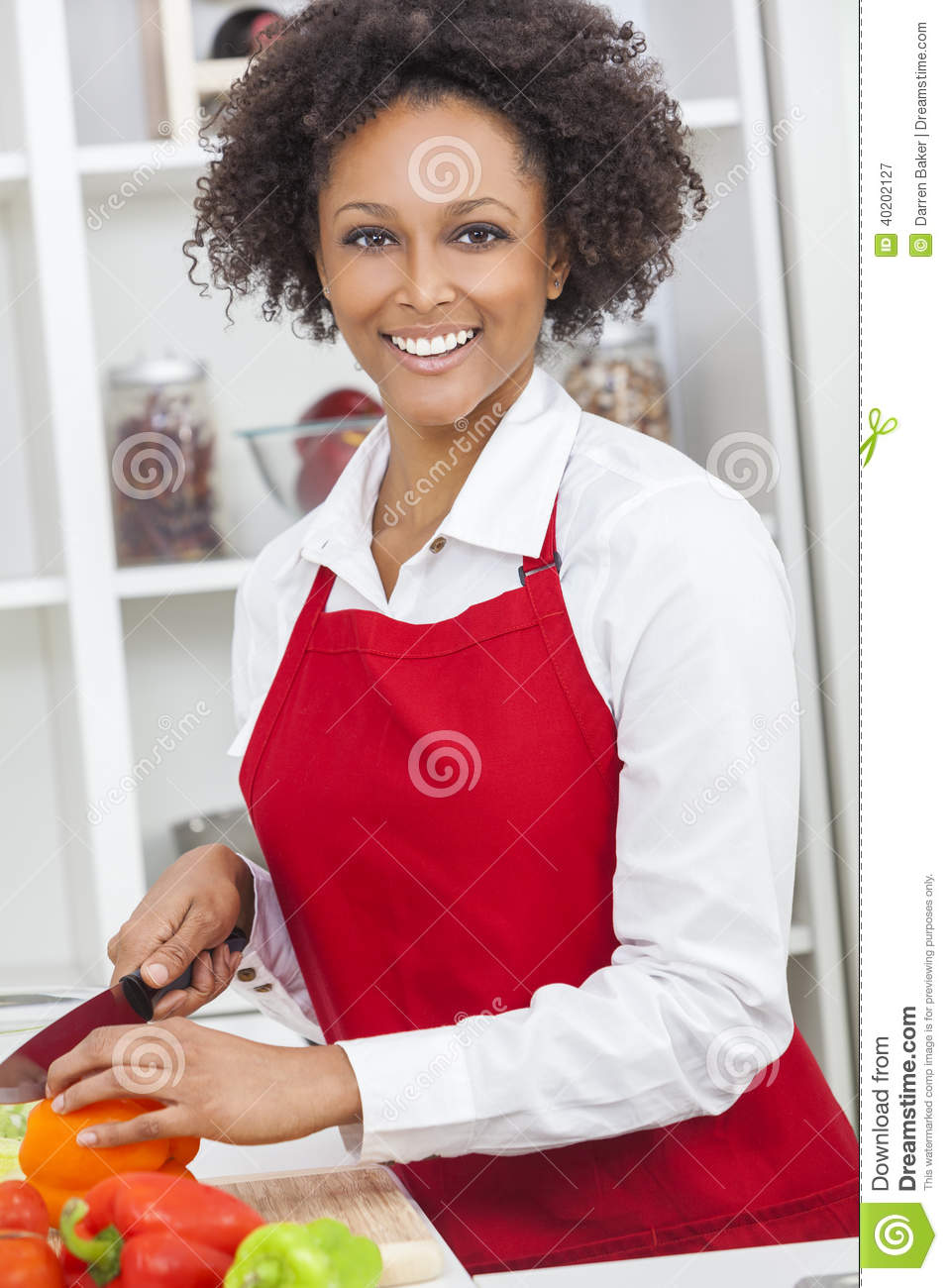 Mixed Race African American Woman Cooking Kitchen Stock