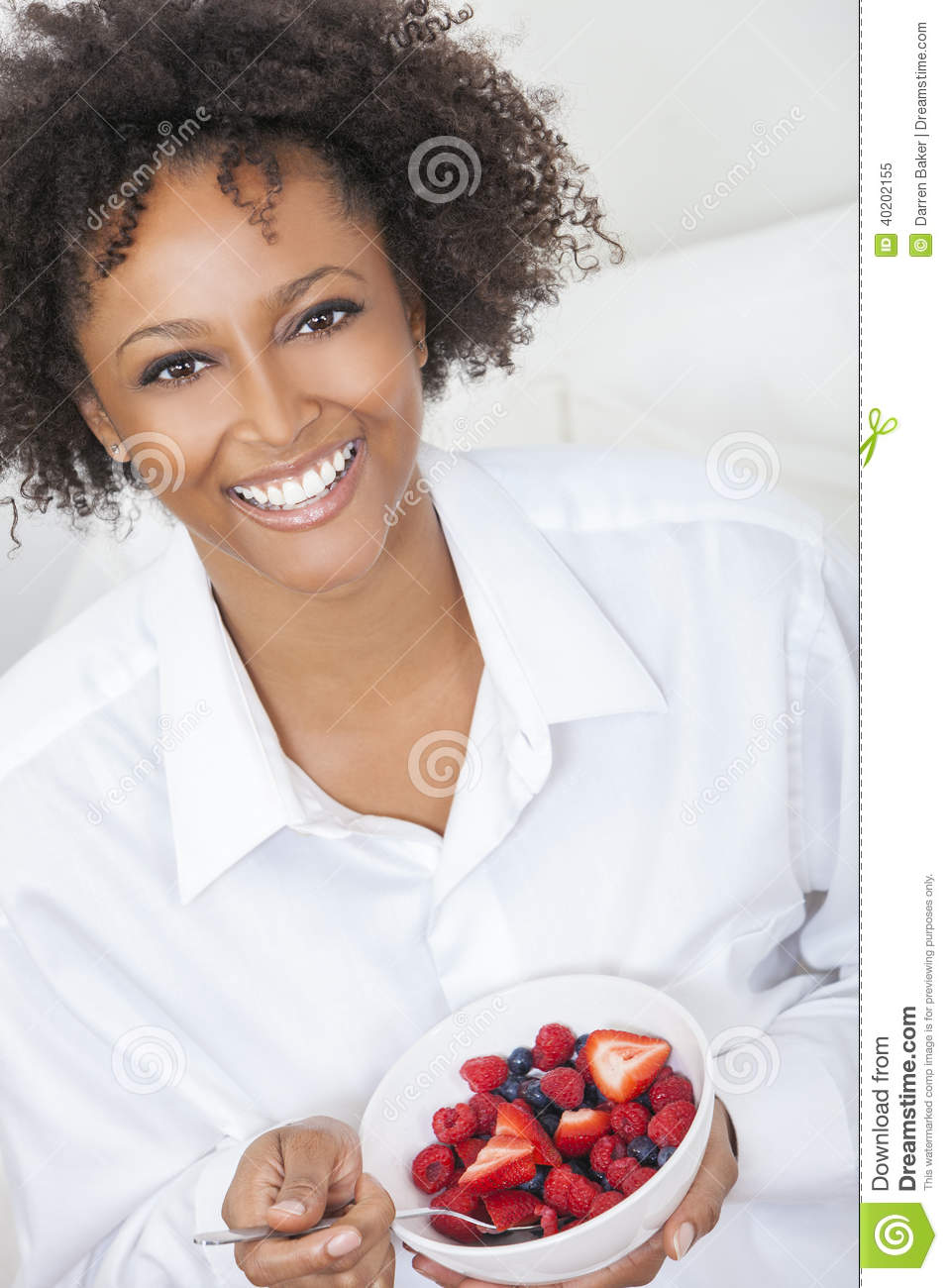 Beautiful Eat In Kitchens: Mixed Race African American Woman Eating Fruit Stock Image