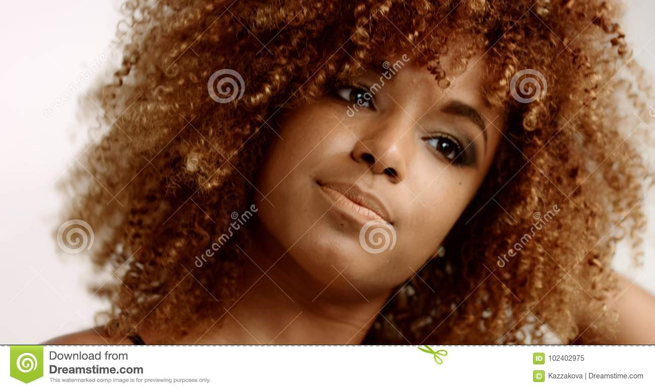 Mixed Race Black Woman With Blonde Curly Hair In Studio Stock Image