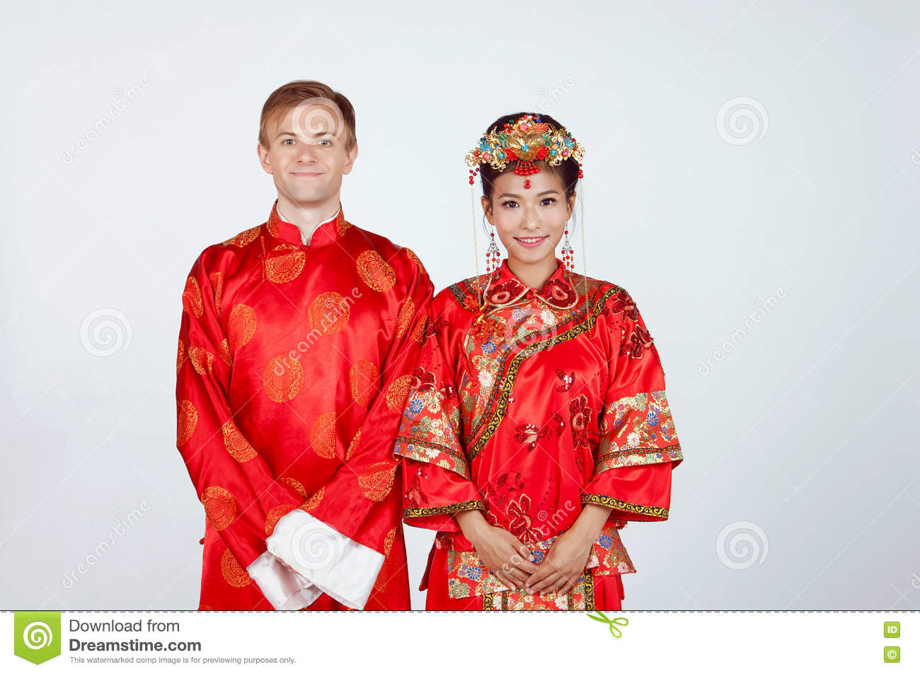 9b9248aba Mixed Race Bride and Groom in Studio wearing traditional Chinese wedding  outfits