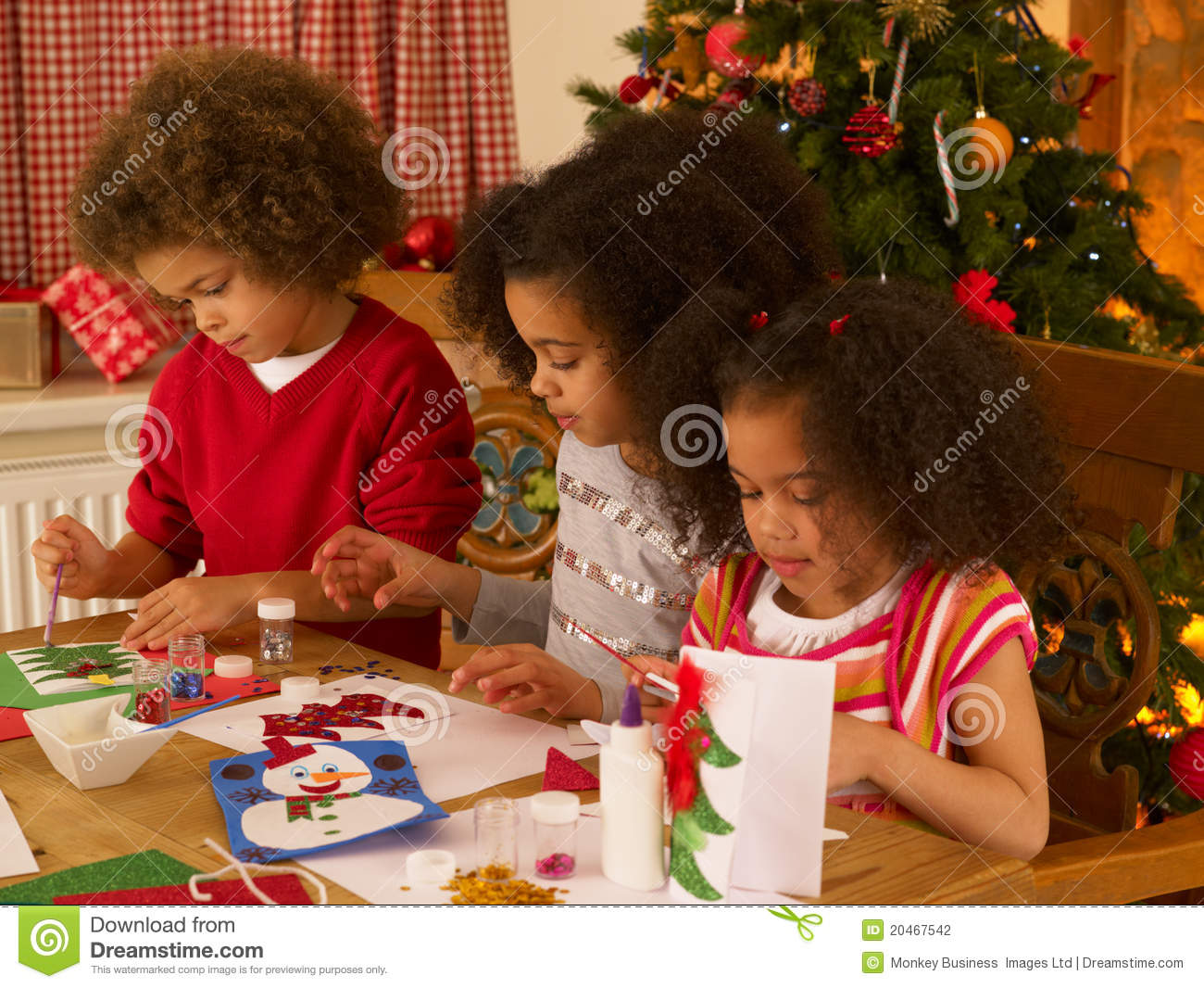 Mixed Race Children Making Christmas Cards Stock