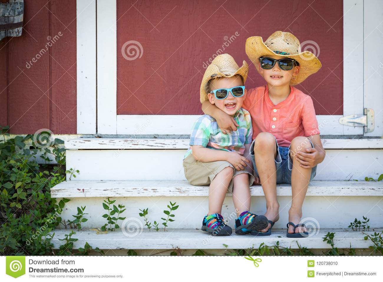Mixed Race Chinese Caucasian Young Brothers Wearing Cowboy Hats