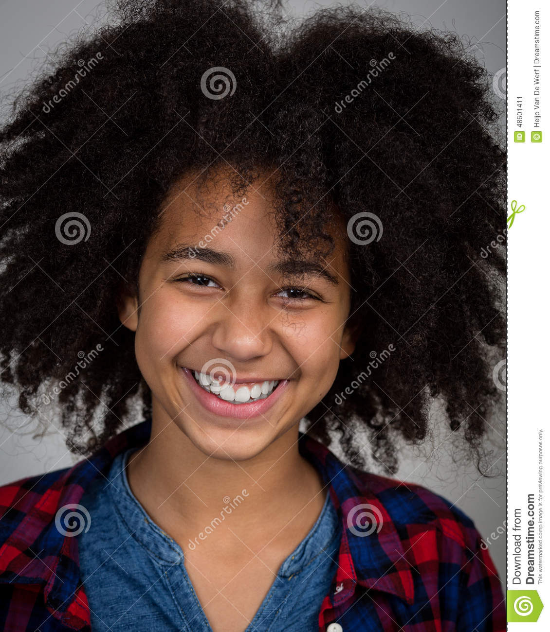 Mixed Race Girl With Afro Hair Style Laughing