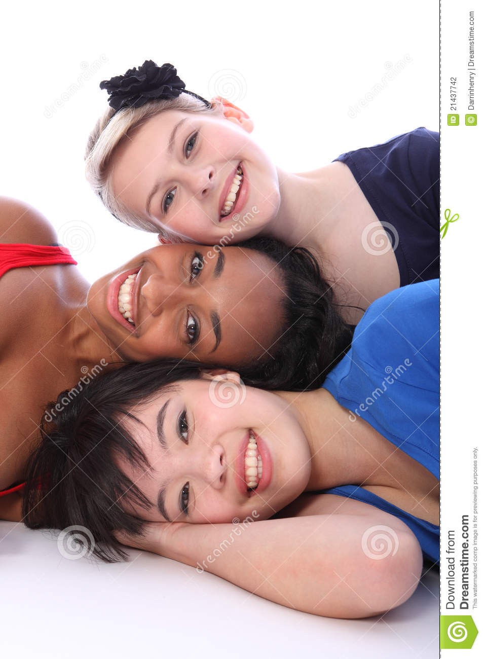 Mixed race happy girls tower of smiling faces