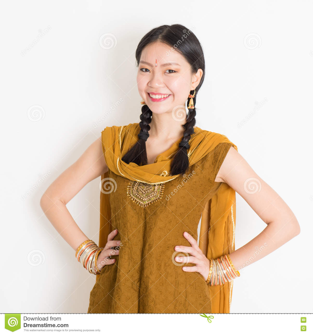 80d8ae29f Portrait of beautiful mixed race Indian Chinese girl in traditional Punjabi
