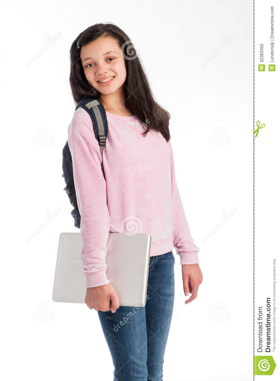 mixed race teenage girl holding a laptop computer stock photo