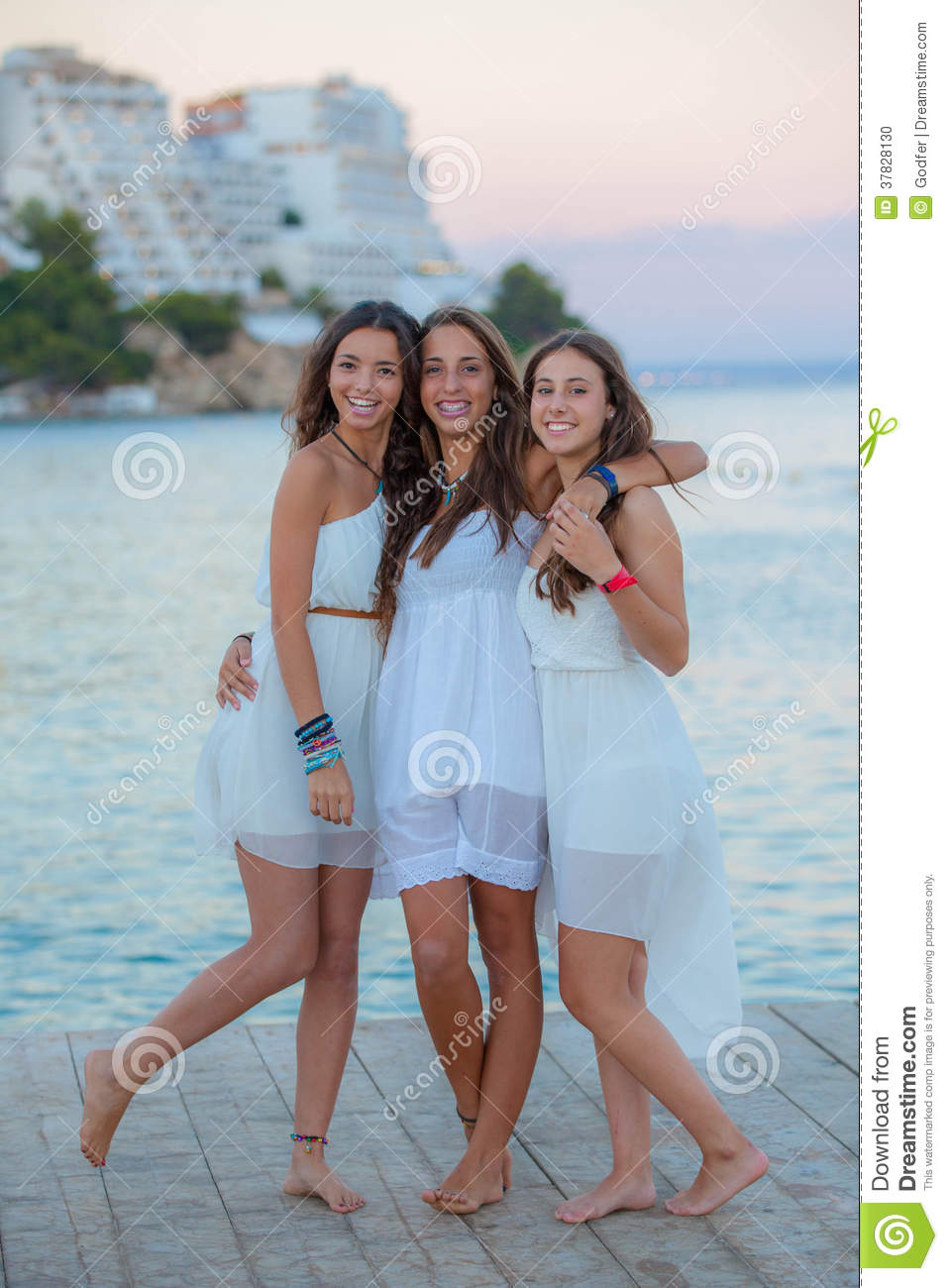 Mixed Race Teens On Summer Vacation Stock Photo