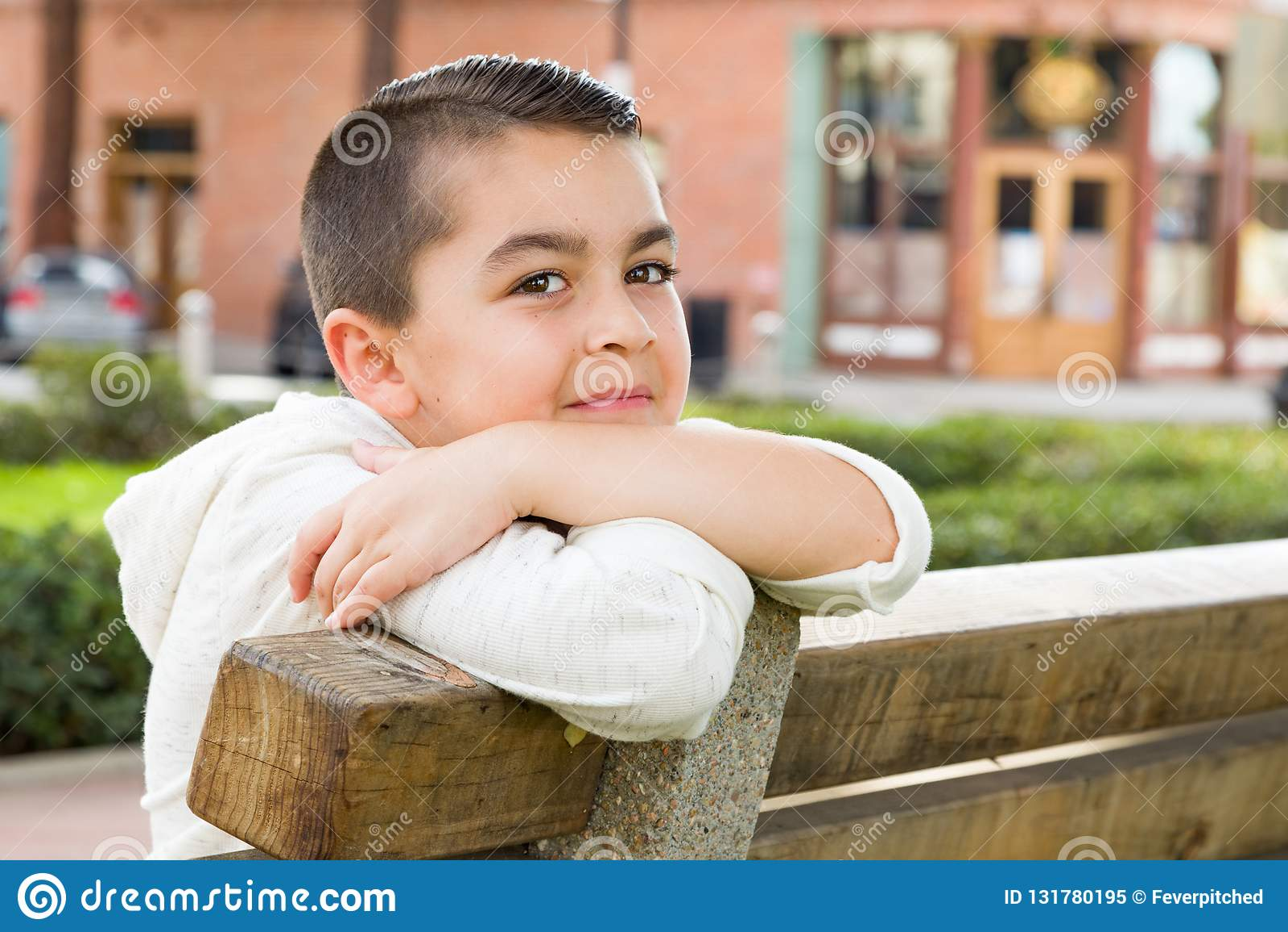 Mixed Race Young Hispanic Caucasian Boy on a Park Bench