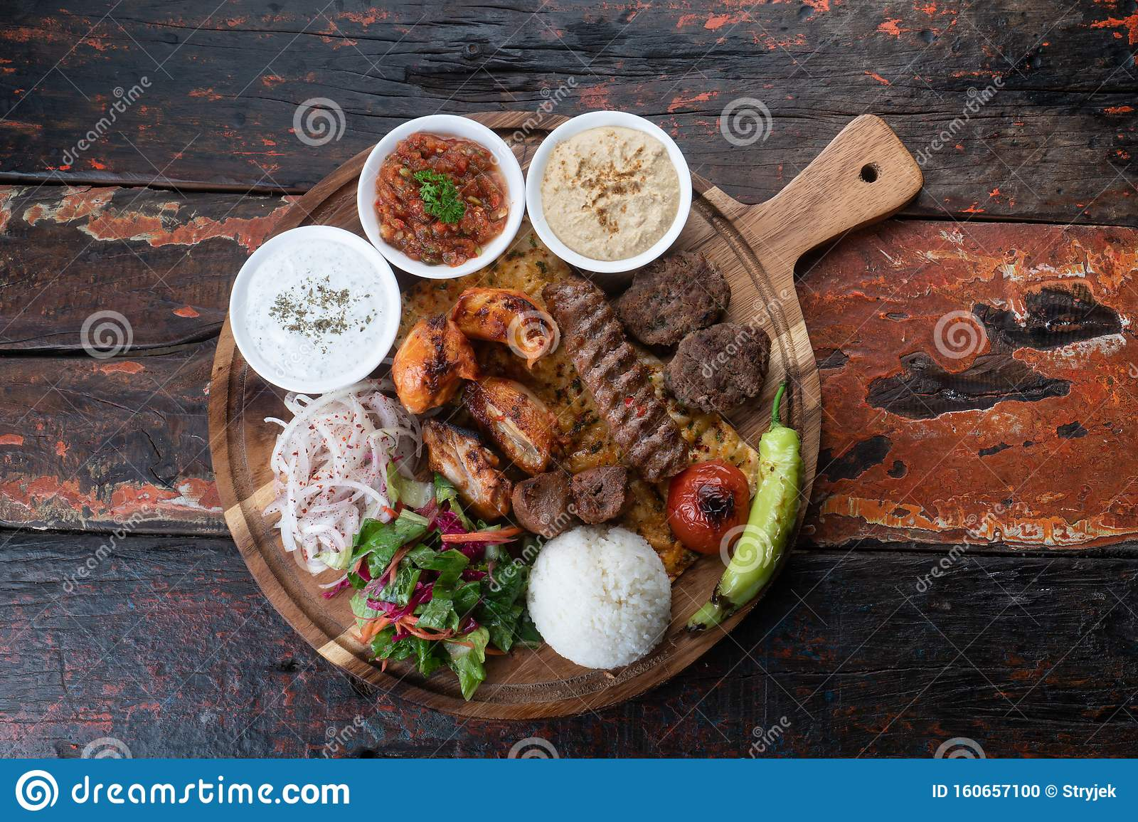 Mixed Turkish Kebab Plate With Rice Vegetables And Dip Sauces On Rustic Wooden Background Stock Photo Image Of Cuisine Eating 160657100