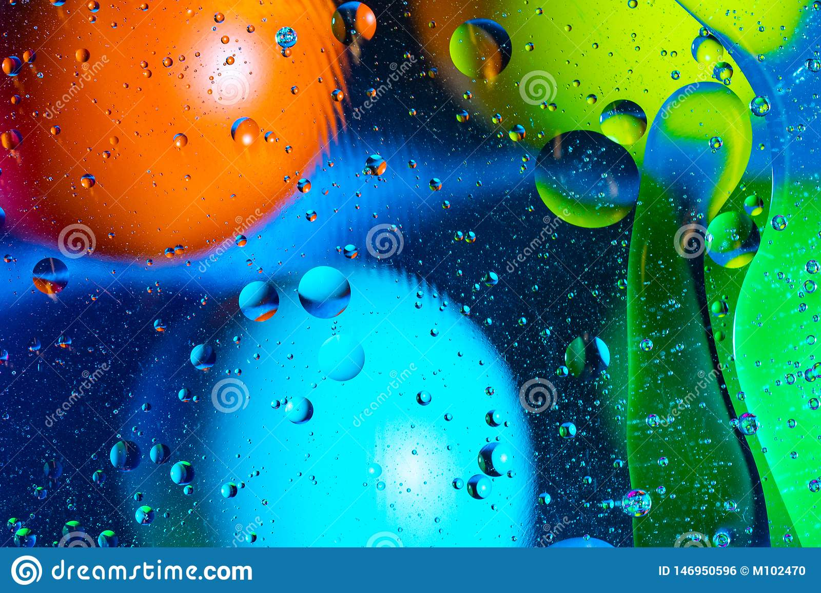 Mixing water and oil on a beautiful color abstract background gradient balls circles and ovals