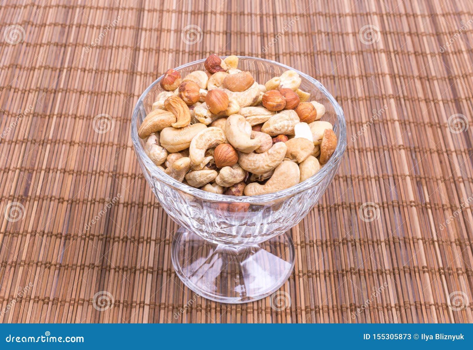 A mixture of cashew nuts, almonds, hazelnuts in a wine glass