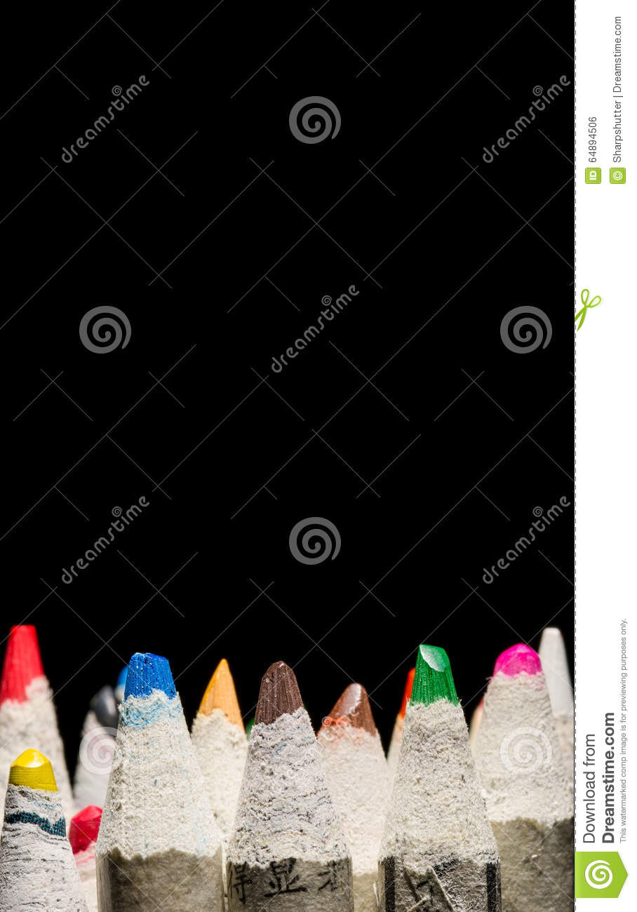 Mmany pencil crayons on black