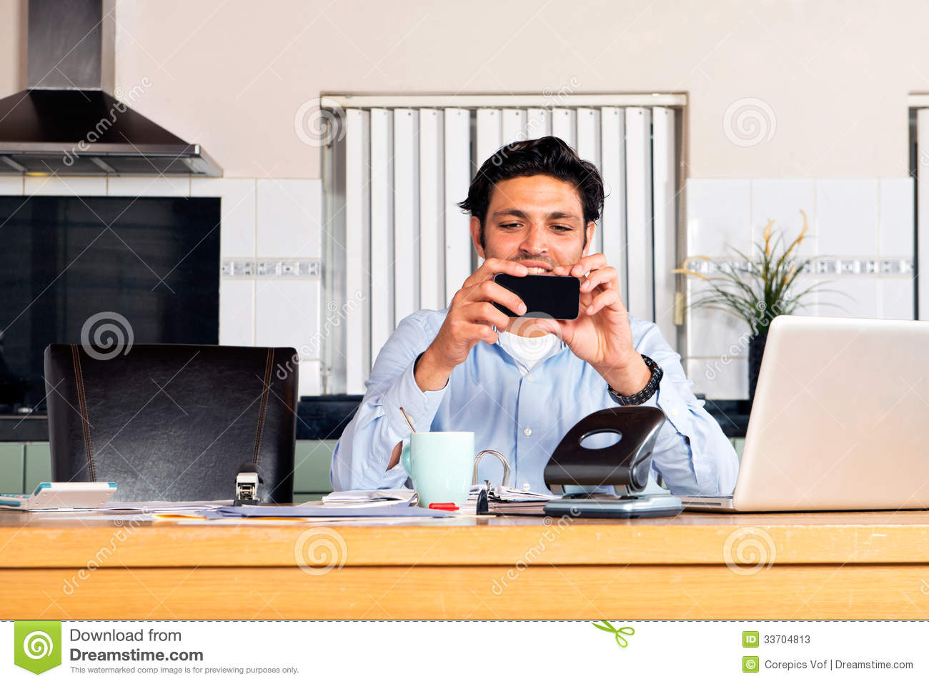 Mobile Banking Stock Image Of Home Laptop Investing 33704813 Wiring Money How To Handsome Man And Paying Bills Using His Phone The New Way Transferring Not Only In A Environment Such As At Kitchen