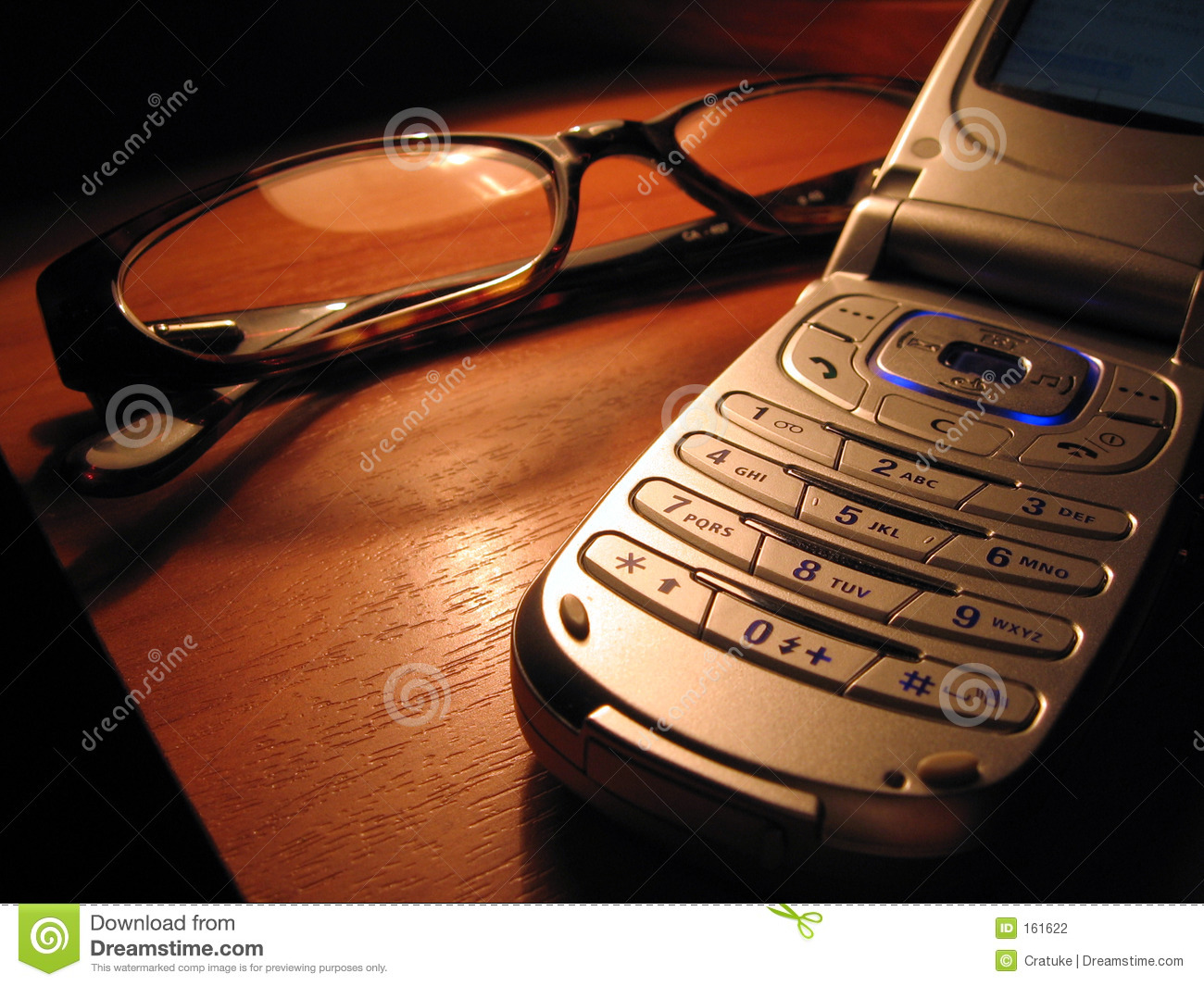Mobile and glasses on the desk