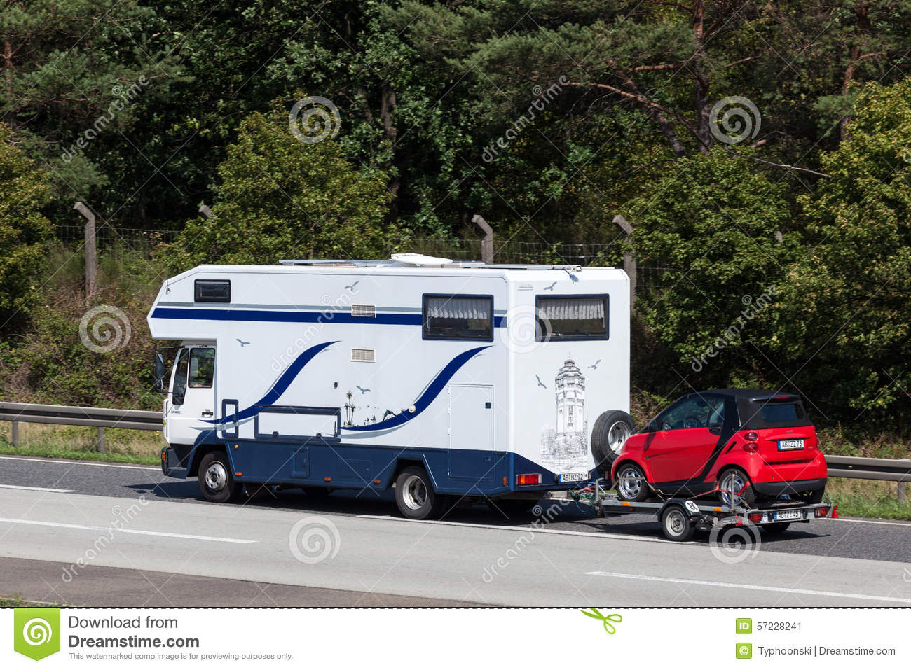 Mobile Home With A Car On Trailer Editorial Photo