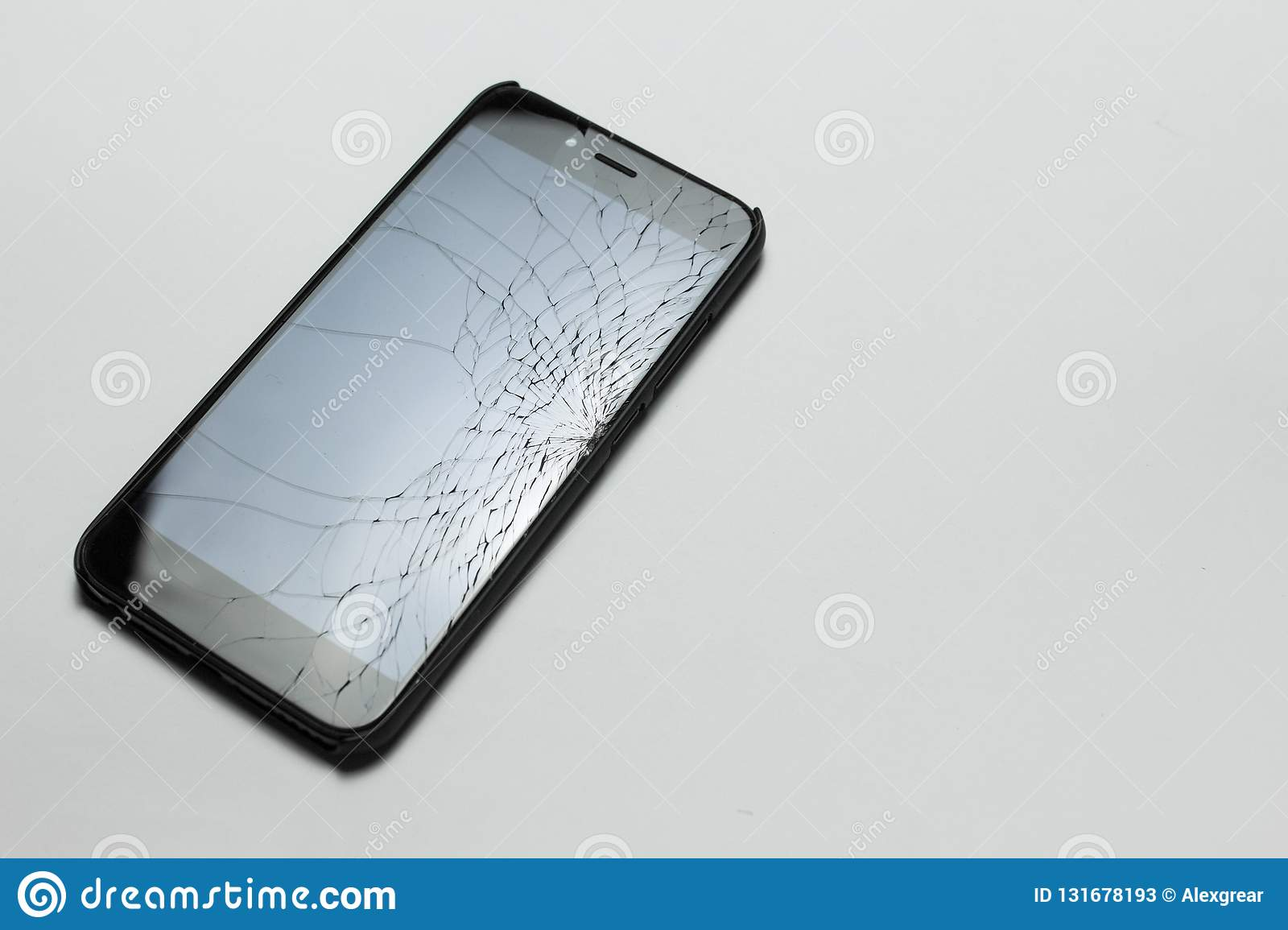 Mobile smartphone with broken screen on white background