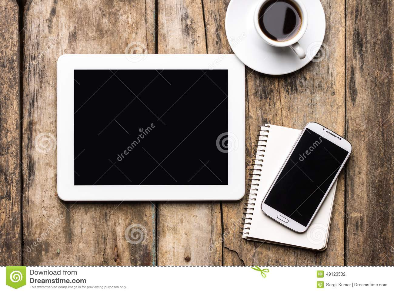 Mobile workplace with tablet PC, phone and cup of coffee