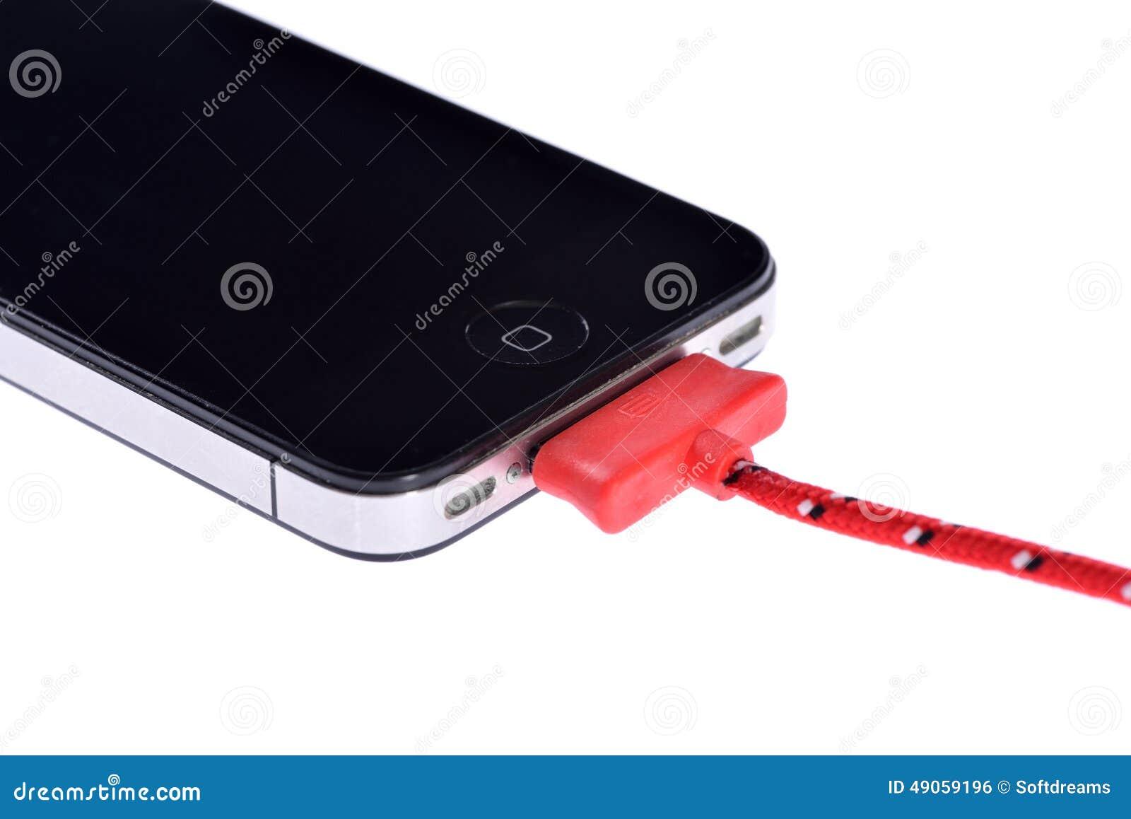 Mobiltelefon och synkroniseringskabel