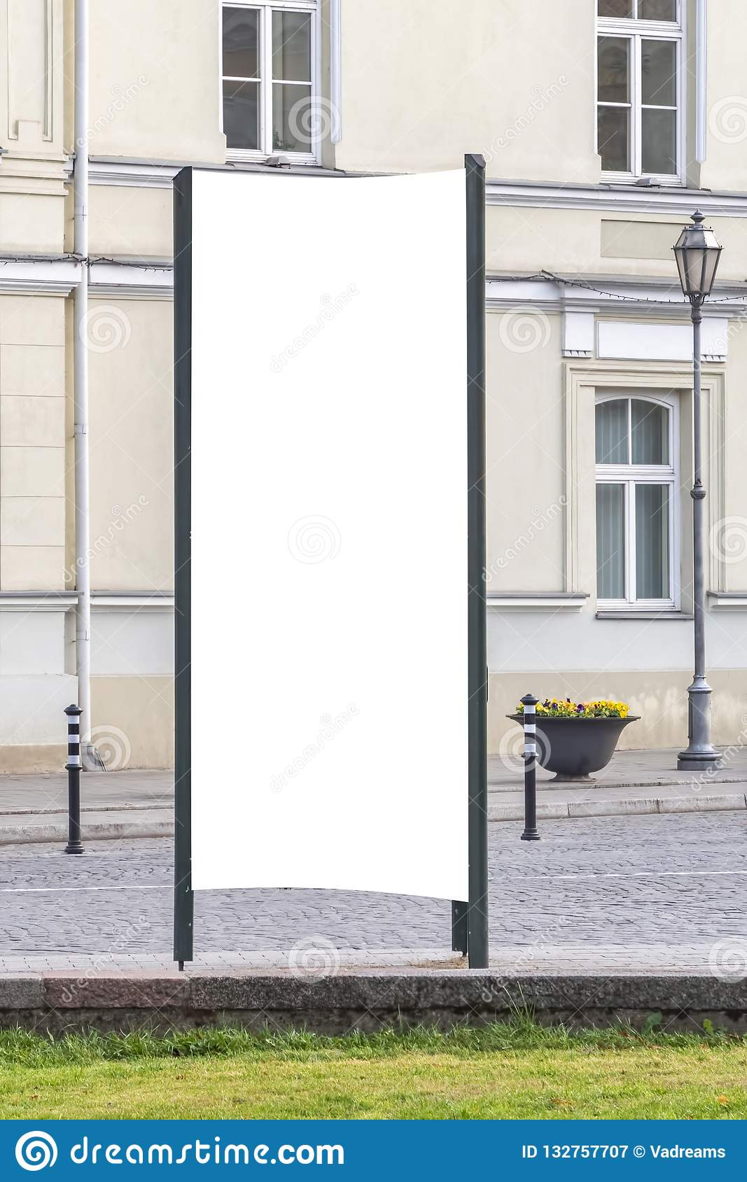 Mock up. Blank outdoor advertising column outdoors, public information board in the street.