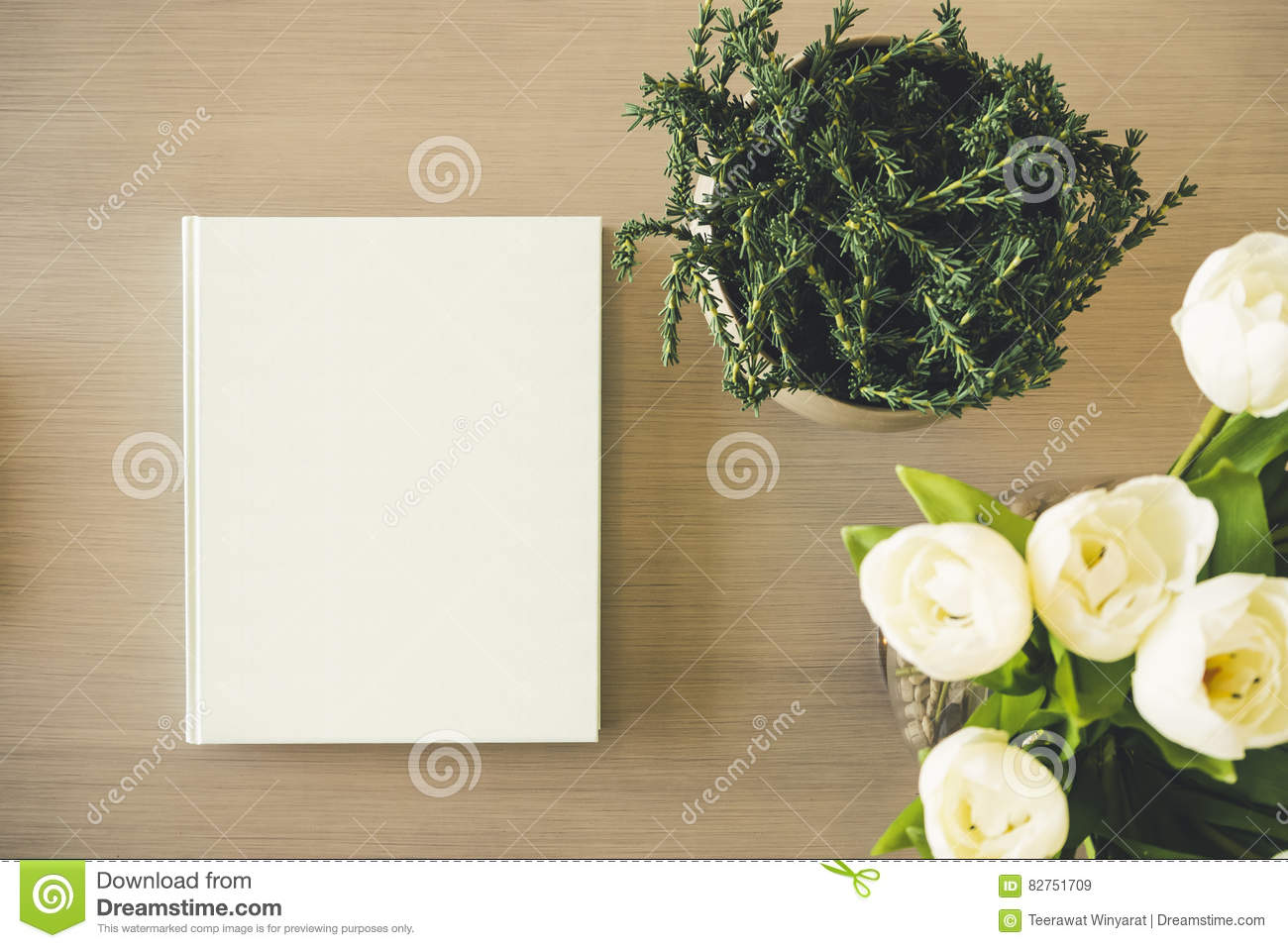 Book Cover Flower : Mock up book cover on table with plant white flower stock