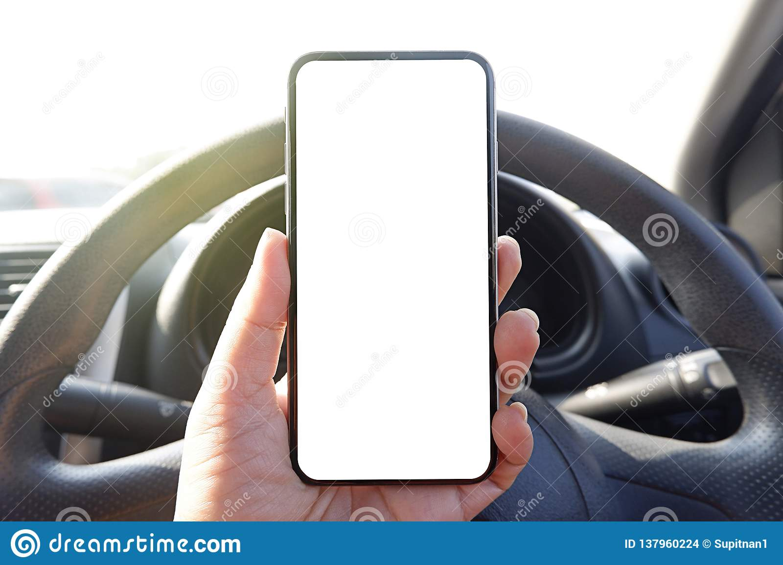 mock up driver hand holding phone in car empty clear screen for text- advertise copy-space background- image