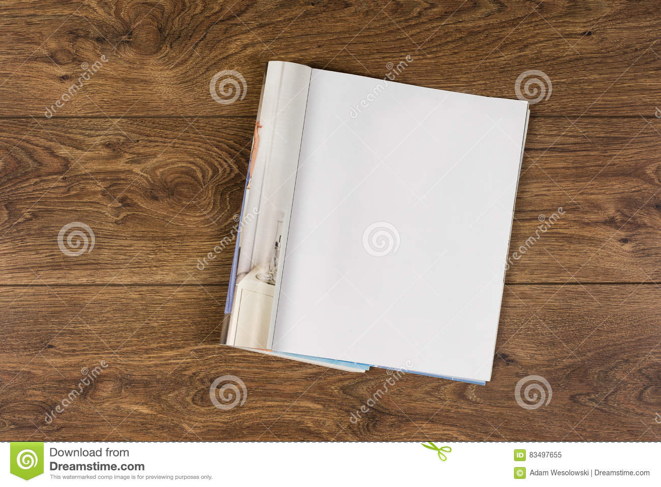 Mock-up magazines or catalog on wooden table background.