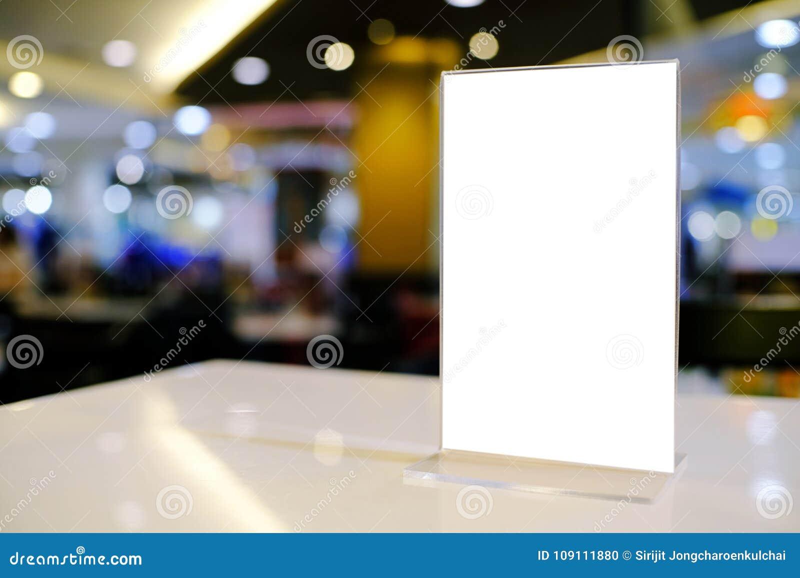 Mock Up Menu Frame Standing On Wood Table In Bar Restaurant Cafe - Restaurant table advertising