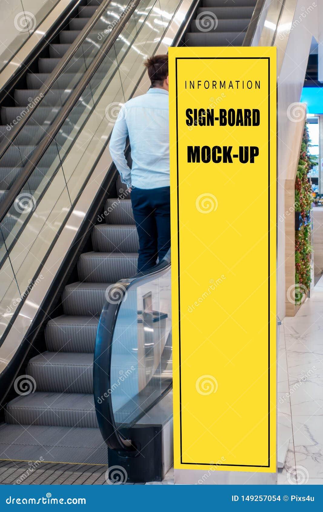 Mock Up Tall Signboard Near Escalator In Shopping Mall Stock Photo