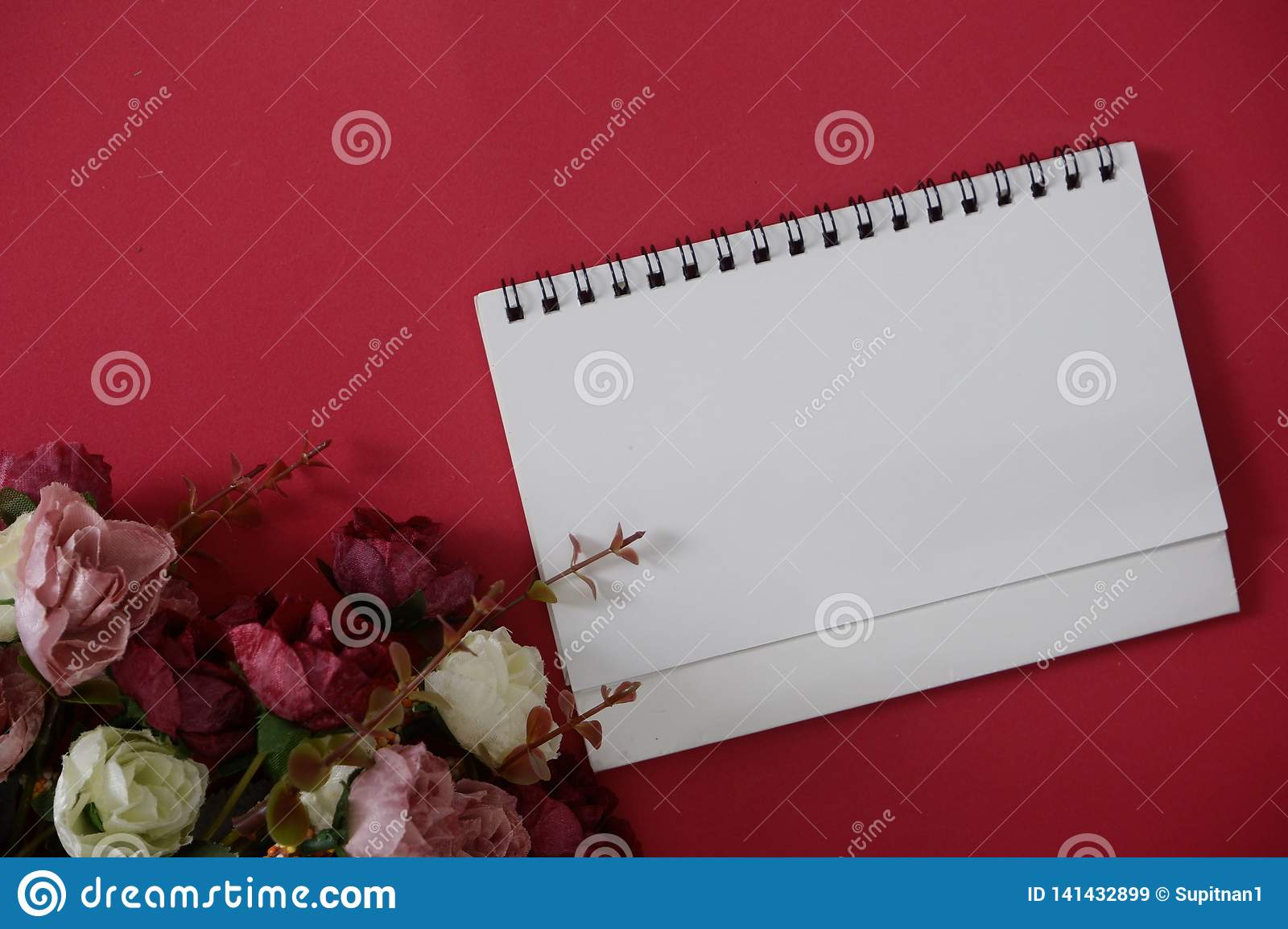 Mock-up white paper with space for text or picture on red background and flower
