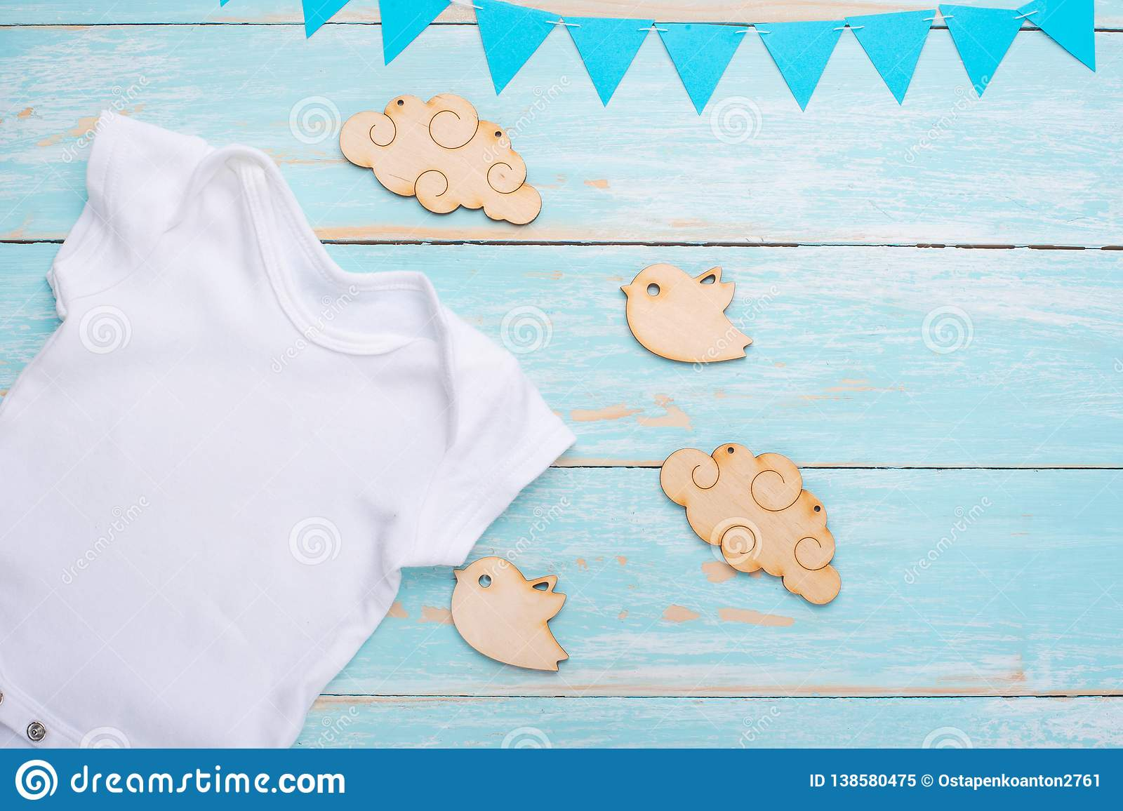 303b5a7065189 Mockup Flat Lay White Baby Shirt With Wooden Toys On A Blue ...