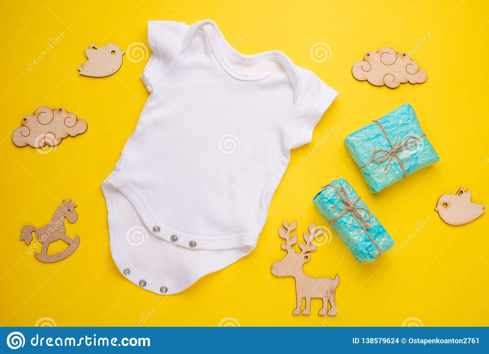 e3e59f9b809ce Mockup Flat Lay A White Baby Shirt With Wooden Toys On A Yellow ...