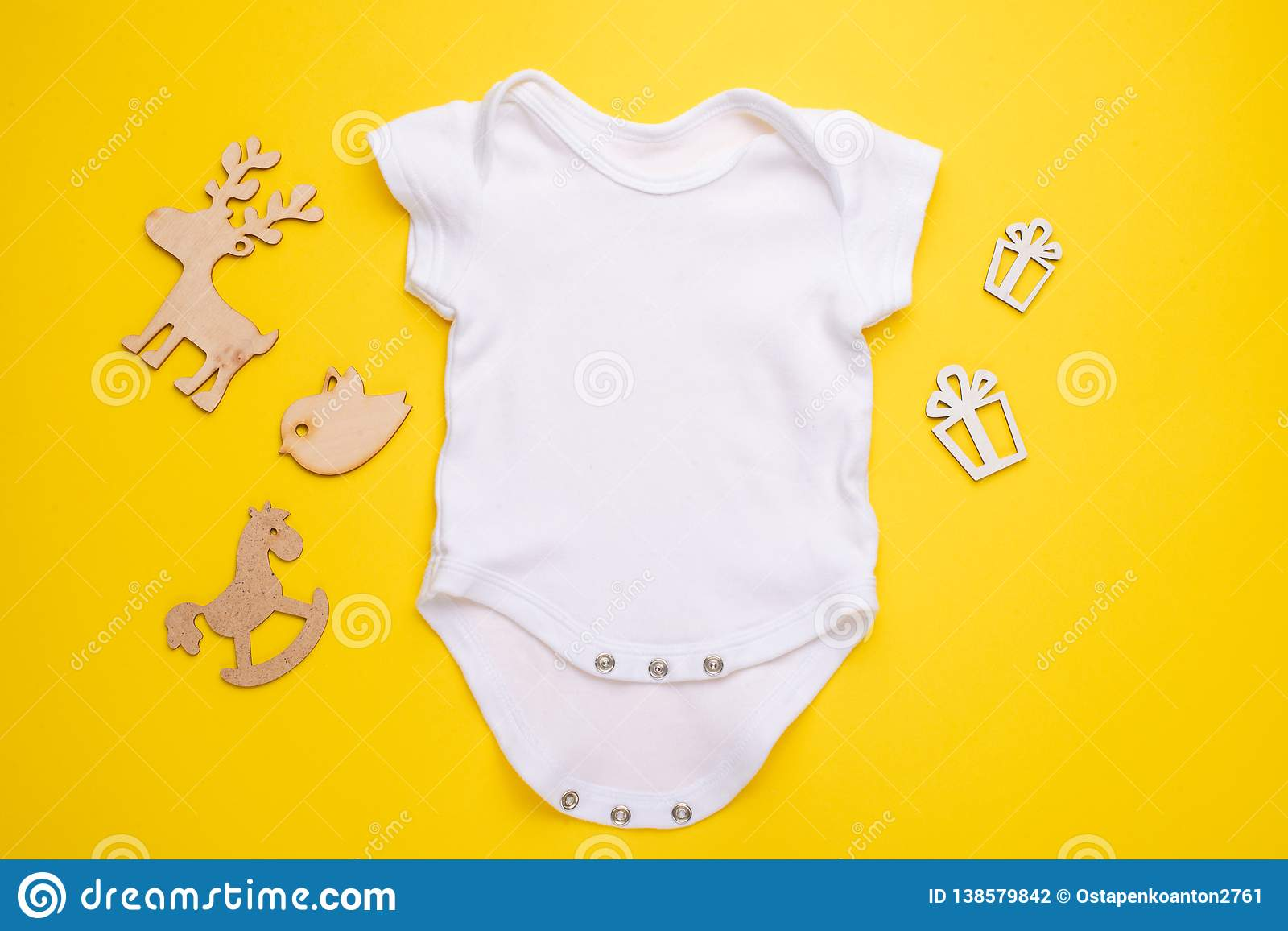 Mockup Flat Lay A White Baby Shirt With Wooden Toys On A Yellow