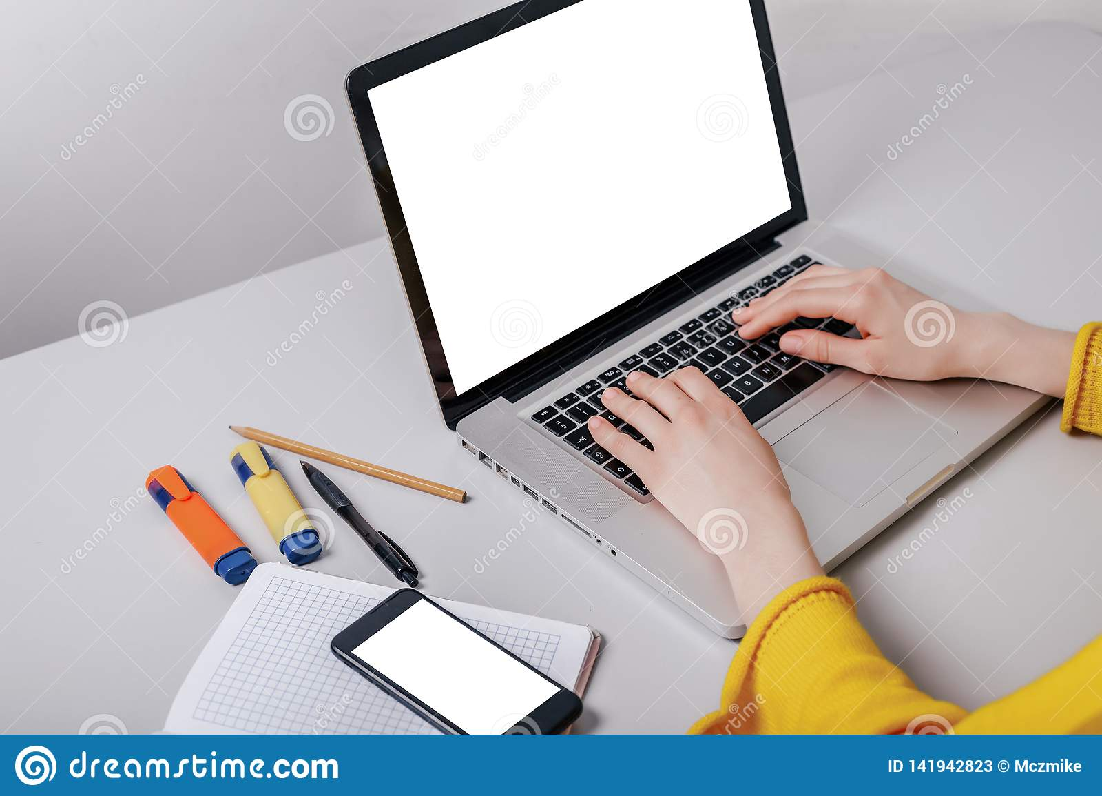 Mockup image cell phone,computer hand typing with blank screen for text, girl using laptop and searching information