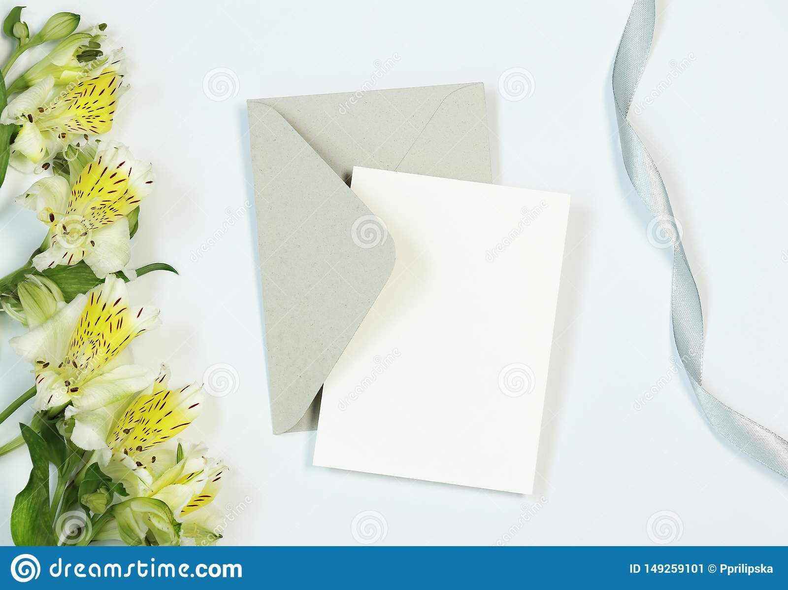 Mockup Invitation Card On White Background With Flowers