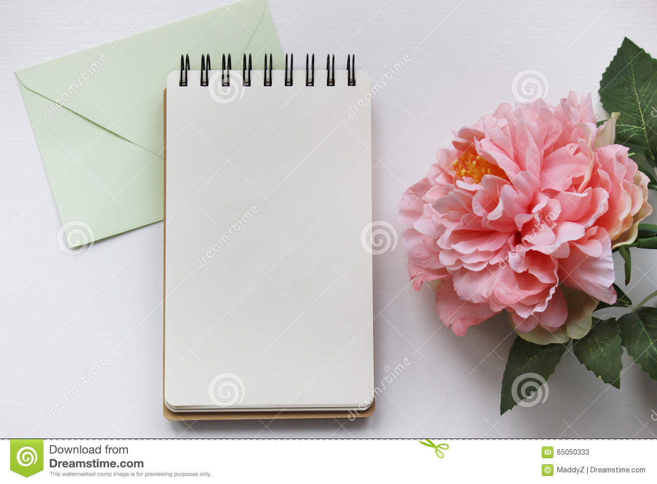 Mockup photography with pink peony, notebook and envelope
