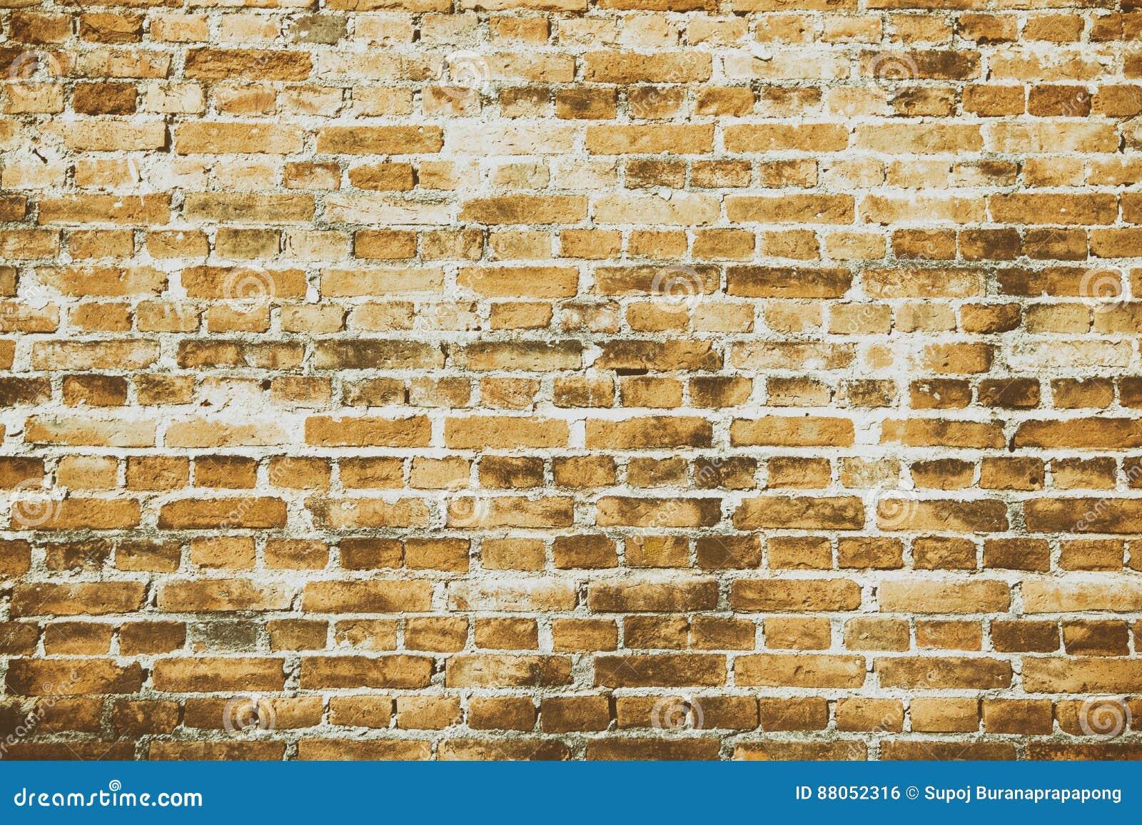 Modèle de vieille structure orange de fond de brique de mur